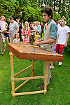 Old Westbury, New York, U.S. 22nd June 2013. Musician MAX ZBIRAL-TELLER is playing a hammered dulcimer at the Midsummer Night event at Old Westbury Gardens, on the grounds of the historic Long Island Gold Coast estate.