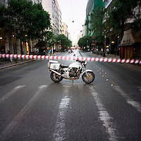 A street closed to the traffic by the police due to a demonstration in the centre of Athens during the financial crisis.