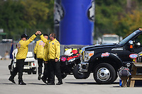 Sept. 30, 2012; Madison, IL, USA: NHRA Safety Safari fist bump before the beginning of the race during the Midwest Nationals at Gateway Motorsports Park. Mandatory Credit: Mark J. Rebilas-