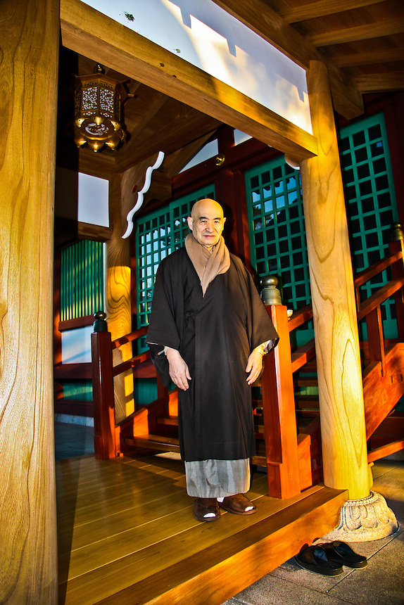 Portrait of Local Buddhist monk standing in entrance to Zenyou-ji temple ..getting ready to feed the birds.