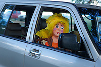female pinata siting in a car