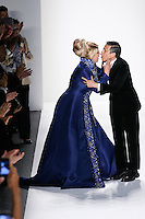 Actress Kirstie Alley, and designer Zang Toi, embrace on the runway at the close of the Zang Toi Spring 2012 My Dream Of North Africa Collection fashioin show, during Mercedes-Benz Fashion Week Spring 2012.