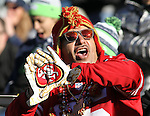 A San Francisco 49ers fan cheers for his team at CenturyLink Field in Seattle, Washington on November 22, 2015.  The Seahawks beat the 49ers 29-13.   ©2015. Jim Bryant Photo. All RIghts Reserved.