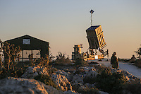 "Israeli soldier stand guard near an ""Iron Dome"" battery, a short-range missile defence system, designed to intercept and destroy incoming short-range rockets and artillery shells, near Jerusalem on September 9, 2013 as the United States lobbied for domestic and international support for military strikes against Syria. Photo by Oren Nahshon"