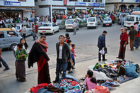 A lama buying a jacket from Thimpu market. Arindam Mukherjee..