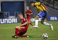 Germany's Patrick Funk (17)  gets under Brazil's Alan Kardec (9)  during the FIFA Under 20 World Cup Quarter-final match at the Cairo International Stadium in Cairo, Egypt, on October 10, 2009. Germany lost 2-1 in overtime play.