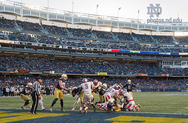 Dec. 28, 2013; Tarean Folston (25) scores a touchdown in the fourth quarter of the Pinstripe Bowl in Yankee Stadium.<br /> <br /> Photo by Matt Cashore
