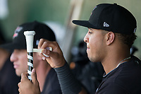 Antonio Rodriguez (14) of the Kannapolis Intimidators tapes his bat handle prior to the game against the Hickory Crawdads at Kannapolis Intimidators Stadium on May 18, 2017 in Kannapolis, North Carolina.  The Crawdads defeated the Intimidators 6-4.  (Brian Westerholt/Four Seam Images)