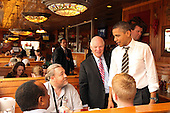 United States President Barack Obama and U.S. Senator Ben Cardin (Democrat of Maryland) greet diners as they wait for their lunch order at Texas Ribs & BBQ in Clinton, Maryland, Thursday, March 15, 2012. The President stopped by to pick up some ribs following his speech on American energy at Prince George's Community College..Credit: Martin Simon / Pool via CNP