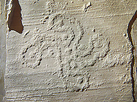 Cast of a prehistoric Petroglyph, rock carving, of a swastika shaped design carved by the Camunni people in the iron age between 1000-1600 BC , Bedolina roccia distrutta, Seradina-Bedolina Archaeological Park Museum, Valle Comenica, Lombardy, Italy
