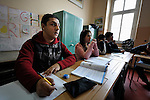 Bajram Kruezi (left) in class at the Branko Pesic School, an educational center for Roma children and families in Belgrade, Serbia, which is supported by Church World Service. Kruezi's family came to Belgrade as refugees from Kosovo, and like many Roma can't afford regular school fees. Many Roma also lack legal status in Serbia, and thus have difficulty obtaining formal employment and accessing government services.