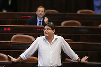 Likud parliament member Ofir Akonis during a vote on the so-called governability law. The governance law would raise the electoral threshold from 2 percent to 4 percent. Photo by Oren Nahshon