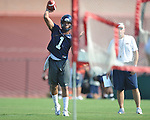 Ole Miss' Randall Mackey (1) throws the ball during a drill at football practice in Oxford, Miss. on Sunday, August 7, 2011.