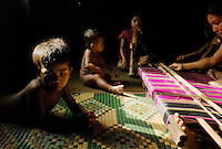 Bolaven plateau, Laos, August 19, 2007.Classic sarong weaving. Bolaven plateau dsplays amazing natural beauty: tropical forest, huge waterfalls, traditional way of life...