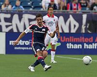 New England Revolution midfielder Benny Feilhaber (22) passes the ball. In a Major League Soccer (MLS) match, DC United defeated the New England Revolution, 2-1, at Gillette Stadium on April 14, 2012.