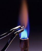 CALCIUM FLAME TEST<br /> Begins to burn<br /> (2 of 3 - Variations Available)<br /> Calcium metal is held over Bunsen burner and begins to burn with orange flame.
