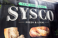 A Sysco delivery truck parked in the NoMad neighborhood of New York on Friday, July 24, 2015. Sysco Corp. has scrapped plans to merge with US Foods after a federal judge put the kibosh on the deal. Sysco is the largest restaurant food distribution company in the U.S. while US Foods is its biggest rival. The court felt that a merge would concentrate the industry and harm competition. (© Richard B. Levine)