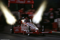"""ENGLISHTOWN, NEW JERSEY: Kenny Bernstein drives the """"Budweiser King"""" Top Fuel dragster in the 1999 NHRA drag race at Englishtown, New Jersey."""
