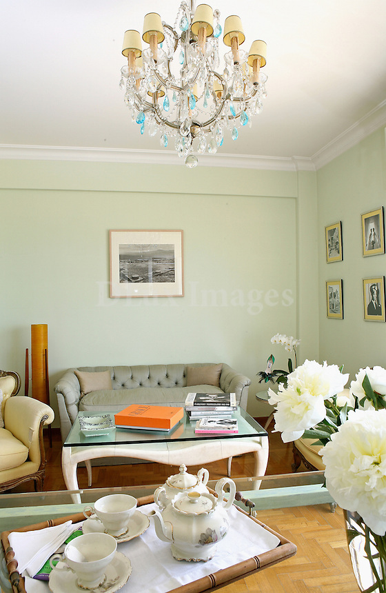 ZOULIAS.. Famous fashion creator Vasilis Zoulias'  house is located near the sea at Paleo Faliro in Athens. The style of the house has many elements of neoclassical architecture of 1957. The apartment is characterized by order, romanticism and a rich variety of pastel colors..