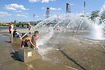 Children play in the Salmon Street Fountain in downtown Portland, Oregon