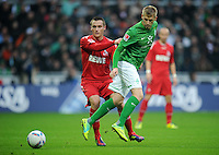 FUSSBALL   1. BUNDESLIGA   SAISON 2011/2012    12. SPIELTAG SV Werder Bremen - 1. FC Koeln                              05.11.2011 Christian CLEMENS (li, Koeln) gegen Aaron HUNT (re, Bremen)