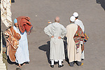 Men selling rugs in the market in Marrakesh, Morocco. .