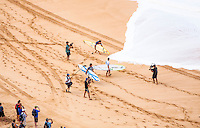 News media representatives get footage of competitors before the latter paddle out at the 2016 Big Wave Eddie Aikau Contest, Waimea Bay, North Shore, O'ahu.