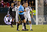LA Galaxy midfielder Landon Donovan is shown a yellow card while teammate David Beckham looks on. The LA Galaxy defeated DC United 2-1at Home Depot Center stadium in Carson, California on Saturday September 18, 2010.