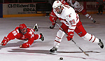 Univeristy of Nebraska at Omaha's Scotty Turner fires a shot past a diving Miami of Ohio's Ben Tarp. during a recent game.<br /> (photo by Chris Machian/Prairie Pixel Group)