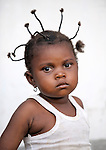 A girl in the Congolese village of Wembo Nyama..