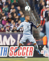 Sporting Kansas City forward Teal Bunbury (9) heads the ball.  In the first game of two-game aggregate total goals Major League Soccer (MLS) Eastern Conference Semifinal series, New England Revolution (dark blue) vs Sporting Kansas City (light blue), 2-1, at Gillette Stadium on November 2, 2013.