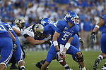 Quarterback Mike Hartline pitches the ball during the first half of UK's home game against Akron, Saturday, September 17, 2010.  Photo by Brandon Goodwin | Staff