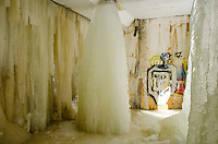 A street scene of graffiti and large ice curtains in Marquette, MI.
