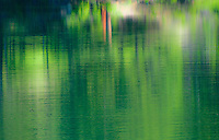 Reflections on a lake create the illusion of an impressionist painting.