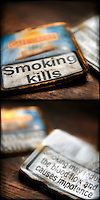 Diptych of empty tobacco tin