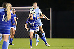 18 October 2012: Duke's Kaitlyn Kerr (5) is fouled by UNC's Kelly McFarlane (11). The University of North Carolina Tar Heels defeated the Duke University Blue Devils 2-0 at Koskinen Stadium in Durham, North Carolina in a 2012 NCAA Division I Women's Soccer game.