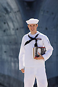 US NAVY ENLISTED SAILOR, model-released, actor, in front of aircraft carrier