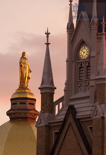 Statue of The Blessed Virgin Mary atop the Main Building and the Basilica of the Sacred Heart, University of Notre Dame.<br /> <br /> Photo by Matt Cashore