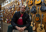 "Musician Ben Harper poses at his family's music store ""Folk Music Center"" in Claremont, California, on December 8, 2012. ©Jonathan Alcorn/JTA."