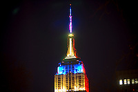 The Empire State Building in New York displays a rainbow of colors, courtesy of their new fancy-schmancy LED lights, for the Christmas holiday, seen on Friday, December 27, 2013. A group of stakeholders in the landmark building has filed a class action suit against the Malkin family, the managing agent for the building, that alleges that the Malkins have cost them over $400 million during the process of going public.  (© Richard B. Levine)