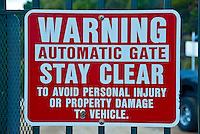 Warning Automatic Gate, Stay Clear, Sign, Red, White Letters, Architectural, Signage, Way finding Systems, stamped out of metal, lettering embossed, printed,