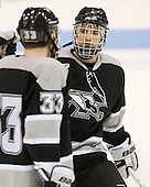 Chris Rooney (Providence - 21) joins Andy Balysky (Providence - 33) on the blue line as the Friar starters are announced. - The Northeastern University Huskies defeated the visiting Providence College Friars 5-0 on Saturday, November 20, 2010, at Matthews Arena in Boston, Massachusetts.