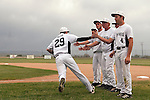 Vale Viking Austin Dayton is cheered on by teammates (L to R: Ryan Tucke, Logan Skerjanec, Cory Erstrom, Ty Holloway, Cody Collins) as he takes the field at the start of the game against the Rogue River Chieftains. This first round 3A Oregon State Baseball Championships game on May 25, 2011 at Cammann Field in Vale, OR matched the number one seed Vikings against the eighth seed Chieftains.