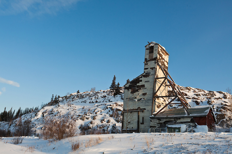 An old mining frame near Yellowknife sits in the cold, crisp winter air.