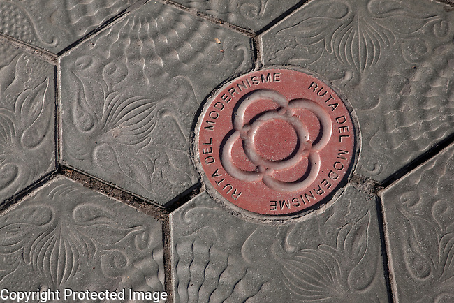 Gaudi Design and Modernism Route Sign on Pavement in Gracia Street in Barcelona, Catalonia, Spain