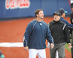 North Carolina-Wilmington pitching coach Jason Howell (left), who was ejected, is escorted off the field by first base umpire Fred Cannon at Oxford-University Stadium in Oxford, Miss. on Saturday, February 25, 2012. Ole Miss won 6-4.
