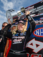 Sep 4, 2016; Clermont, IN, USA; NHRA funny car driver Courtney Force celebrates with the trophy after winning the Traxxas Shootout speciality race during qualifying for the US Nationals at Lucas Oil Raceway. Mandatory Credit: Mark J. Rebilas-USA TODAY Sports