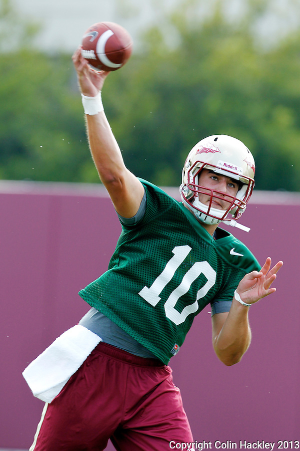 TALLAHASSEE, FLA.8/6/13-FSU080613CH-Florida State quarterback Sean Maguire throws during practice Aug. 6, 2013 in Tallahassee, Fla.<br /> <br /> COLIN HACKLEY PHOTO