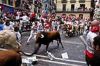 The Running of the Bulls (encierro de los toros) during the San Fermín fiesta in Pamplona, Spain, 8 July 2005.