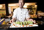 Chef Toshitaka Kasseki serves up Cterpillar Roll, featuring eel, avocado and sweet soy sauce at The Barn restaurant  in Hirafu in the Niseko ski region of Hokkaido, Japan on Feb. 6 2010. Kasseki is the former head chef at the Hong Kong Marriott.